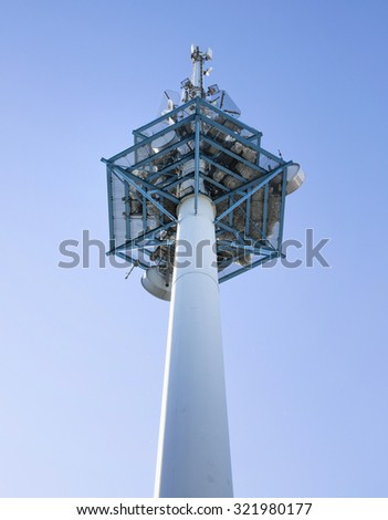 High telecommunications tower on blue sky