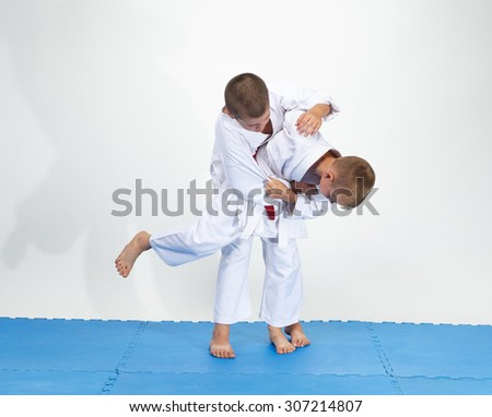 High throw judo an athlete is doing with white belt