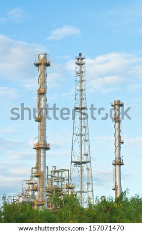 High tower and pole in oil refinery factory  - stock photo