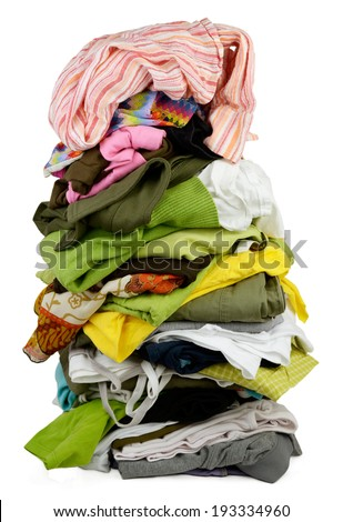 High tower of folded but a bit messy clothes  - stock photo