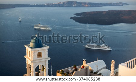 High vantage point view over Santorini's Caldera from Imerovigli, the highest village on this Greek island, in the sunrise light - stock photo