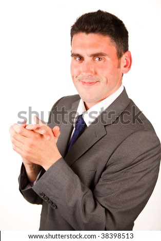High view of smiling businessman clapping against white background