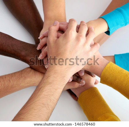 High view of team of friends showing unity with their hands together - stock photo