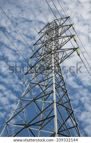 high voltage electric pole blue sky background
