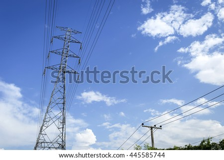 High voltage electric pole with and city electric pole in summer sunny day blue sky