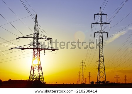 High voltage - electric power lines at the sunset