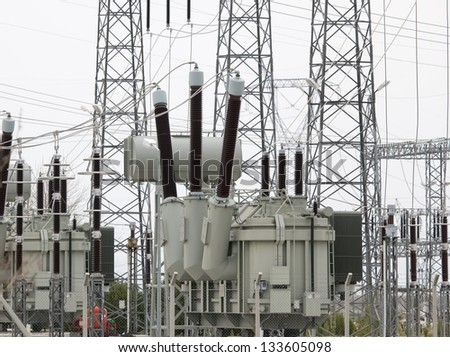 High Voltage electric substation with transformers - stock photo