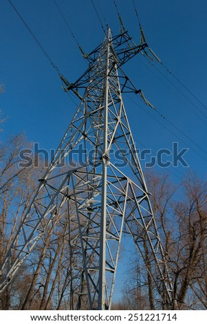 High Voltage Electric Tower Against Blue Sky - stock photo