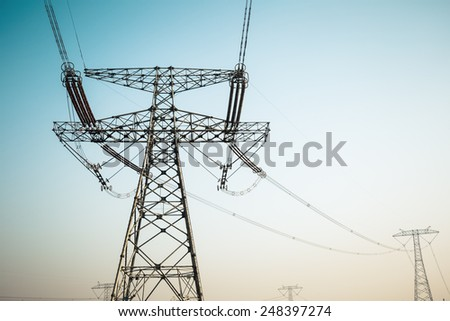 high voltage electric tower , strong electricity transmission background - stock photo