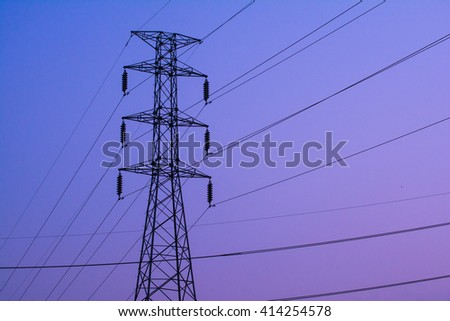 High Voltage Electric Transmission Tower , Power Cables High Voltage  with sunset . - stock photo