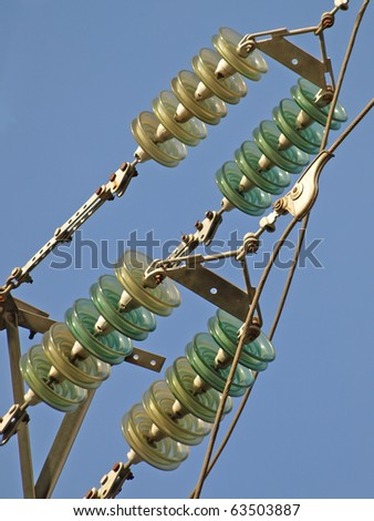 High voltage electrical insulator electric line against the  blue sky.