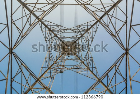 high voltage electrical post and wire up angle dynamic view in clear blue sky - stock photo
