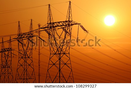high voltage electrical tower during sunset