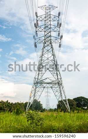 high voltage electrical towers in line - stock photo