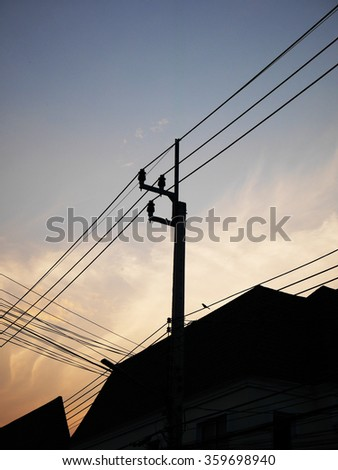 High voltage electricity pole in the evening