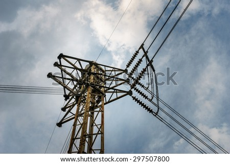 high voltage electricity post junction with sky background - stock photo