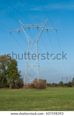 High voltage electricity pylon against rural landscape