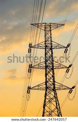 High voltage electricity pylon against the backdrop of the morning.