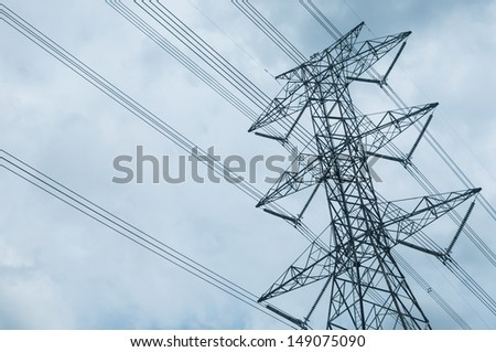 High voltage electricity pylon and the sky with many clouds - stock photo