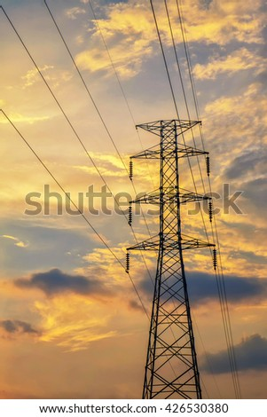 High voltage electricity pylon at time sunset