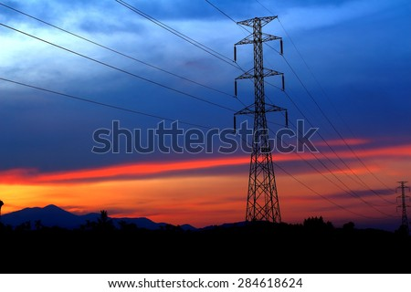 High voltage electricity pylon over Twilight
