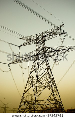 high voltage electricity pylons near dusk