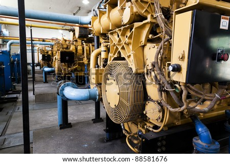 high voltage industrial standby diesel generator at a power generation plant in a textile factory.