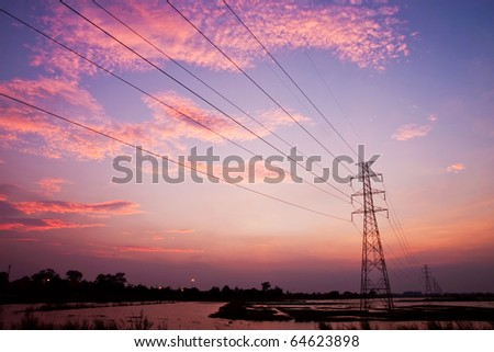 high voltage line over twilight sky - stock photo