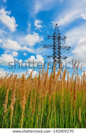 High voltage lines against a background of cloudy sky - stock photo