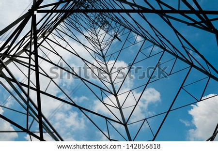 High voltage lines against a background of cloudy sky