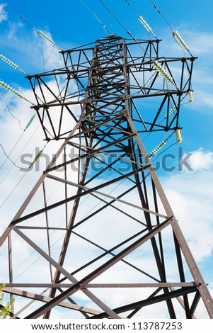 High voltage lines beneath the blue sky