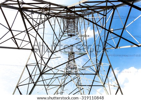 High-voltage lines under the blue sky