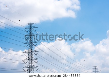 High Voltage post. High-Voltage Electric Tower in the blue sky background.