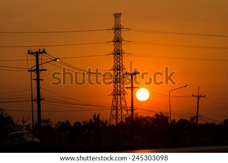 high voltage post.High-voltage tower and sunset