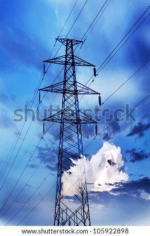 high voltage post.High-voltage tower blue and cloudy sky background. - stock photo