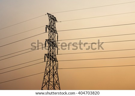 high voltage post.High-voltage tower sunset background.