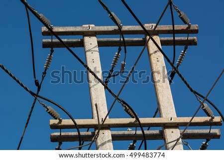 high voltage post.High-voltage tower with sky background.