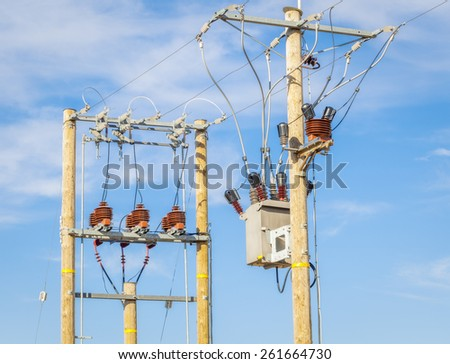 High voltage power divider and transformer on blue sky   - stock photo
