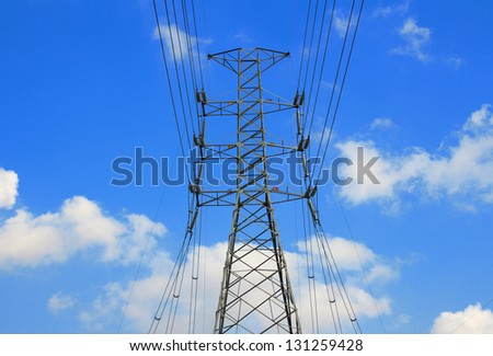 High-voltage power line on the shore - stock photo