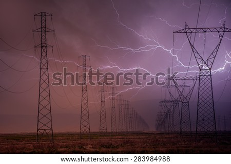High voltage power lines and lightning - stock photo