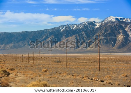 High voltage power lines near Sierra Nevada mountains, California