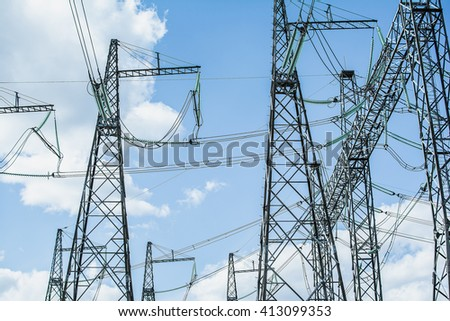 High-voltage power lines on the sky background