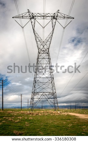 High Voltage Power Lines running through the Antelope Valley on a cloudy day