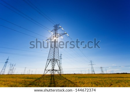 High voltage power lines with backlighting effect.