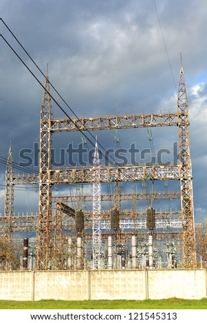High voltage power lines with  clouds