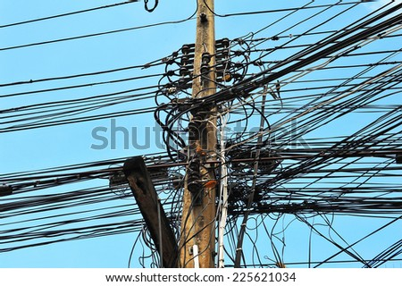High voltage power pole with wires tangled - stock photo