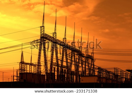 High voltage power transformer substation, sunset - stock photo