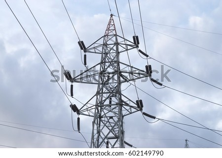 High voltage power transmission tower. Power tower with cloud background