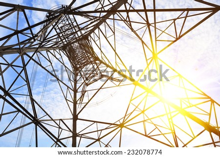 High-voltage power transmission towers - stock photo