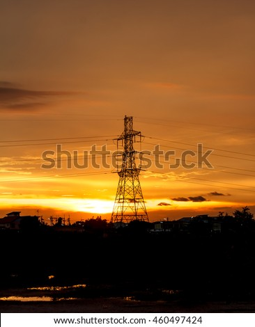 High voltage pylons on the evening sunset, silhouette